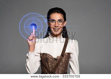 Front View Of Excited Attractive Steampunk Woman Showing Idea Sign Isolated On Grey