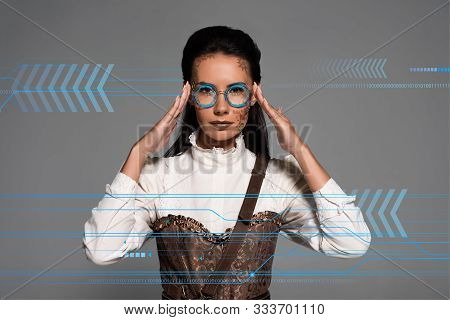 Steampunk Woman Touching Glasses Isolated On Grey With Data Illustration