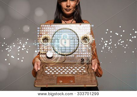 Cropped View Of Steampunk Woman In Top Hat With Goggles Showing Vintage Laptop With Internet Securit