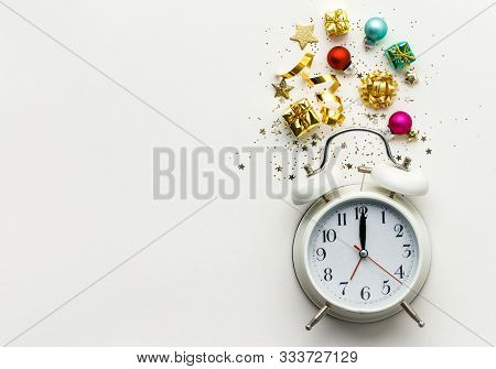 Christmas Or New Year Composition On White Background With Retro Alarm Clock And Christmas Decoratio