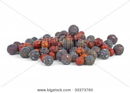 Herbs: small pile of dried red juniper (Juniperus oxycedrus) and high juniper (Juniperus excelsa) berries isolated on the white background poster