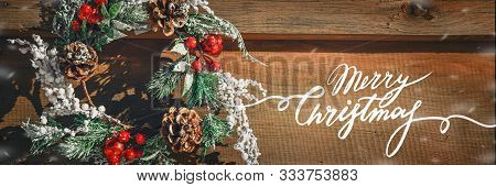 Advent Christmas Wreath On Wooden Door Decoration. Lettering Merry Christmas Minimal Winter Vacation