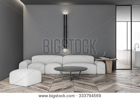 Interior Of Modern Living Room With Gray Walls, Wooden Floor, Comfortable White Sofa With Round Coff