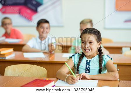Portrait Of Children In Shool At The Lesson