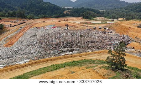 Landfill full of plastic rubbish dumped in forest in Malaysia. Plastic sent for recycling is instead just dumped, polluting the environment