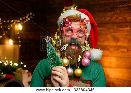 Santa Claus Hold Tree. New Year Clothes. Christmas Eve. Santa In Home. Santa Claus. Merry Christmas