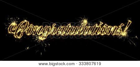 Congratulations Banner With Glitter Decoration And Fireworks. Text Congratulations Written Sparkling
