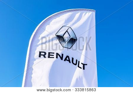 Samara, Russia - October 26, 2019: Dealership Flag Of Renault Against The Blue Sky. Renault Is The F