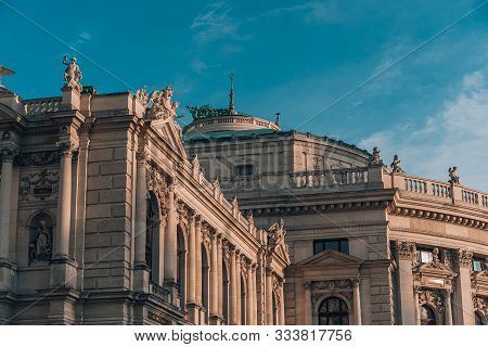 Facade Of Burgtheater In Vienna During Golden Hour Sunset