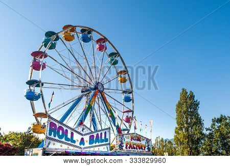 Sept. 2, 2012 - Vancouver, Canada: Colourful Fairground Ferris Wheel And Midway At Pne Fair On A Sun