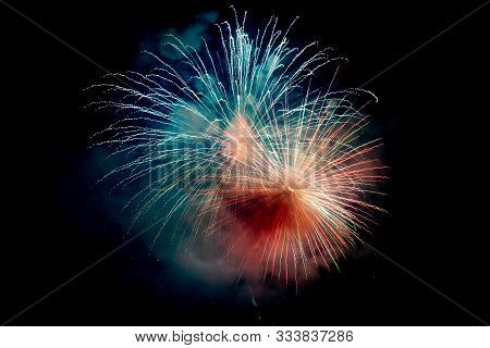 Blue Orange Sparkling Fireworks Background On Night Scene. Abstract Color Fireworks Background And S