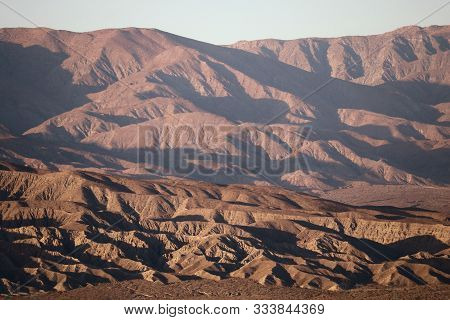 Sun Setting On Arid Mountains Creating Natural Shadows On The Desolate Landscape Taken In The Colora