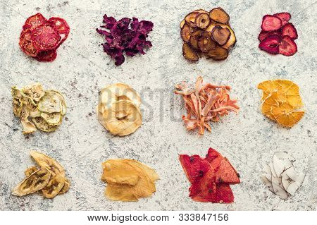 Healthy Homemade Fruit And Vegetable Chips On Grey Background. Organic Diet Food. The Vegan Diet. Dr