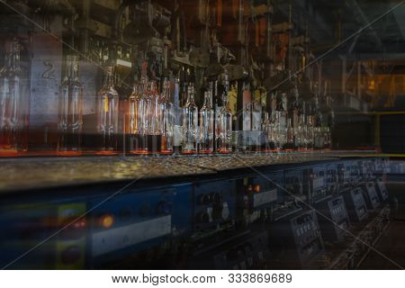 Glassworks. Glass Industry. Glass Bottle During Conveyor Belt Manufacturing