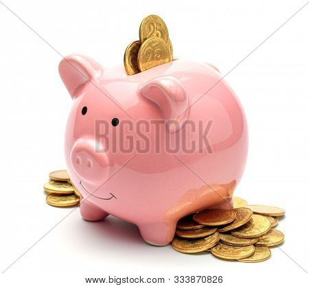 Pink Piggy Bank Full Of Gold Coins Isolated On A White Background. Concept Of Where To Invest Your S