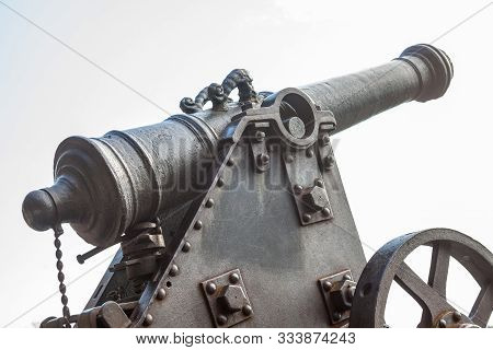 poster of Old metal cannon. Ancient fire-arm weapon. Ancient artillery.