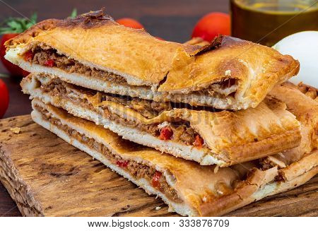 Tuna Pie. Typical Galician Dish (galicia) And Spain. With Natural Ingredients Such As Tomato, Onion,