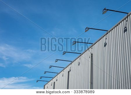 Street Architecture Outdoor Lamp Hanged And Cantilevered From The Wall Of The Building Which Is Meta