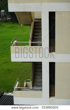 Side View Of The Vintage Oldies Apartment Building With Staircase