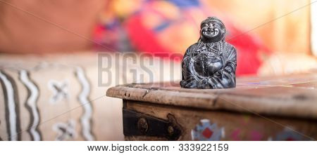Spirituality And Feng Shui Concept: Buddha Statue In The Living Room. Relaxation, Balance And Spirit