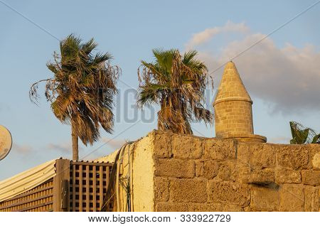 Old Arabic Fortress On The Background Of Palm Trees