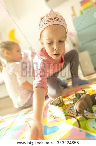 Girl Play With A Wooden Set