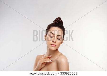 Beauty Concept. Woman Applying Cosmetics Cream. Female Holds A Bottle Cream In Her Hand And Spreads