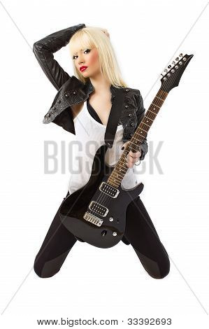 Sexy Beautiful Blonde Woman In Black Leather Jacket Posing With Black Electric Guitar
