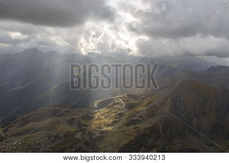 Sunbeams Passing Clouds And Are Reflected In The Green Mountains From The Lentilla Peak In France. N