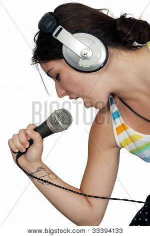 Attractive Brunette With Headphones And A Microphone (5)