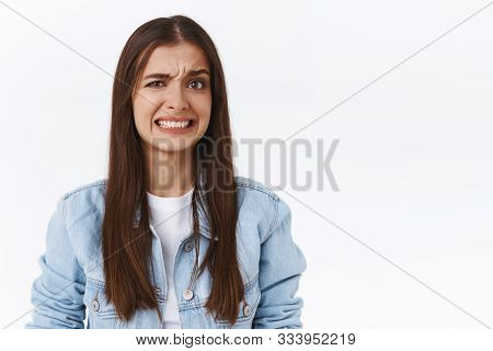 Girl Cringe As Seeing Something Embarrassing And Bothering. Woman Make Uncomfortable Smile And Squin