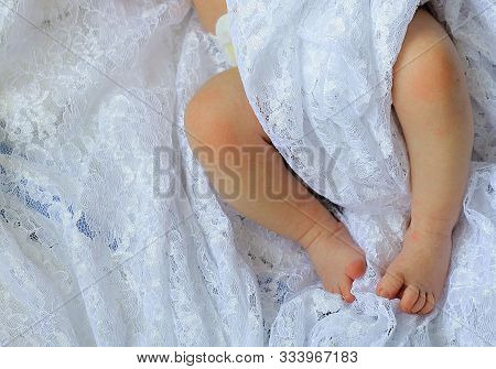 Baby Feet In Bed Wrapped Up In Fabric Stock Photo