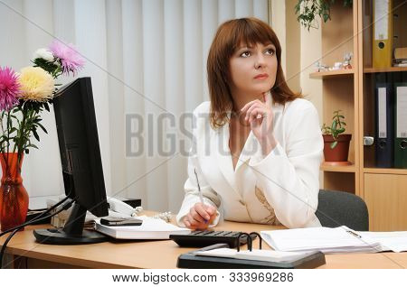 Troubled Adult Attractive Caucasian White Brunette Woman Holding Pen Above Calculator. Computer, Flo