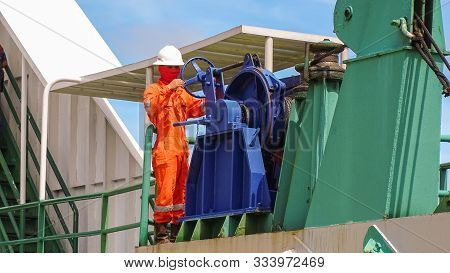 Labuan,malaysia-july 29,2019: Crewman Or Seaman Working On Foredeck Of Ro Ro Ferry Boat Preparing To