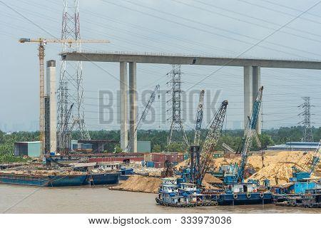 Long Tau River, Vietnam - March 12, 2019: Construction Of Phuoc Khanh Suspension Bridge Under Blue S