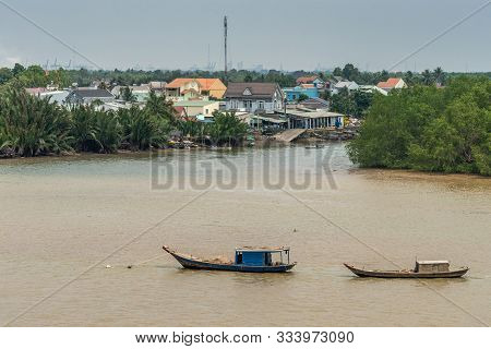Long Tau River, Vietnam - March 12, 2019: 2 Sloops Are Anchored On Brown Water. Phuoc Khanh Riversid
