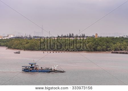 Long Tau River, Vietnam - March 12, 2019: Small Blue Ferry For Pedestrians With Or Without Bikes Cro