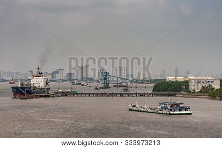 Long Tau River, Vietnam - March 12, 2019: Phuoc Khanh Petroleum Port With Pier, Dock And Tanks. Prim