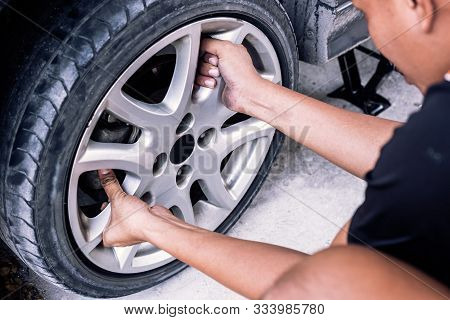 Change A Flat Car Tire At Car Park With Tire Maintenance, Damaged Car Tyre