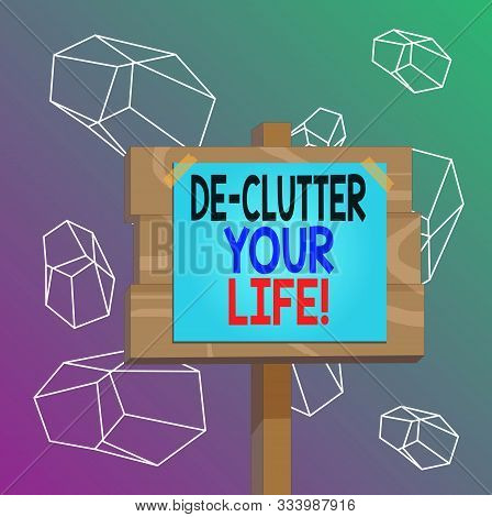 Word writing text De Clutter Your Life. Business concept for remove unnecessary items from untidy or overcrowded places Wood plank wooden stick pole paper note attached adhesive tape empty space. poster