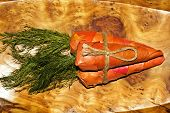 An unusual gift of three carrots made from vine leaves poster