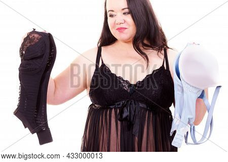 Plus Size Fat Woman Wearing Lingerie Holding Black And Bright Bras, Choosing Witch Bra To Wear, On W