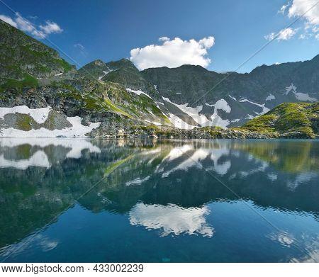Beautiful summer landscape of Caucasus mountain. Arkasar Dukka lakes near Arkhyz village in Russia. Daylight mountain landscape.