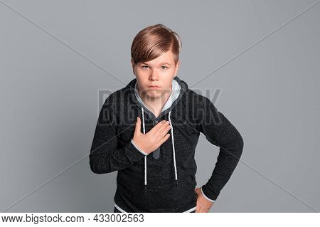 Confused Teen Boy Pointing Displeased And Frustrated To The Himself Hand, This Is Not Me, Stands Ove