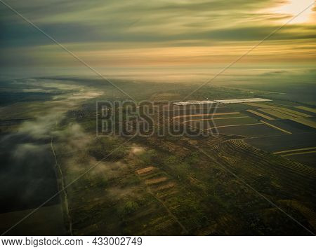 Aerial View On The Field During Sunset. Landscape From Drone. Agricultural Landscape From Air. Agric