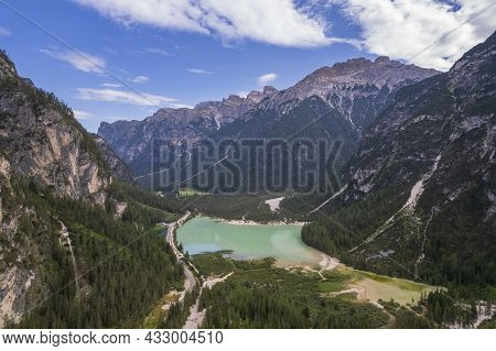 A Majestic View Of Durrensee Lake In Italy Surrounded By Beautiful Forested Mountains In The Dolomit