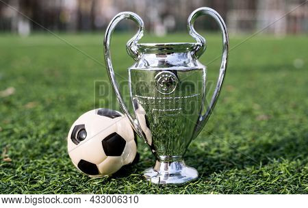 April 16, 2021 Moscow, Russia. The Uefa Champions League Cup On The Green Grass Of The Lawn.