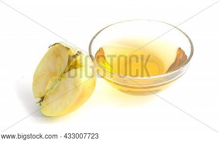 A Half Of An Apple And A Bowl With Apple Cider Vinegar Isolated On White Background.