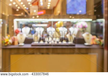 Gold Jewelry Diamond Store Window Display Abstract Blur With Bokeh Light Background
