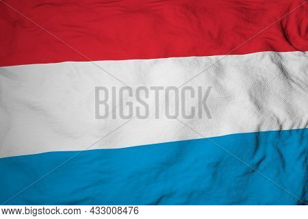 Full Frame Close-up On A Waving Flag Of Luxembourg In 3d Rendering.